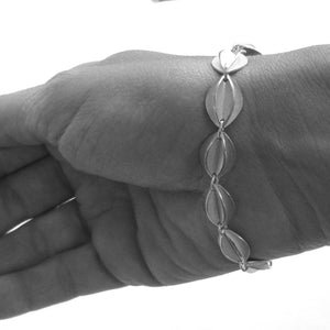 Contemporary sterling silver bracelet, leaf shape, handmade and bespoke by Sue Lane Jewellery. Perfect for Silver wedding anniversary, 21st birthday present