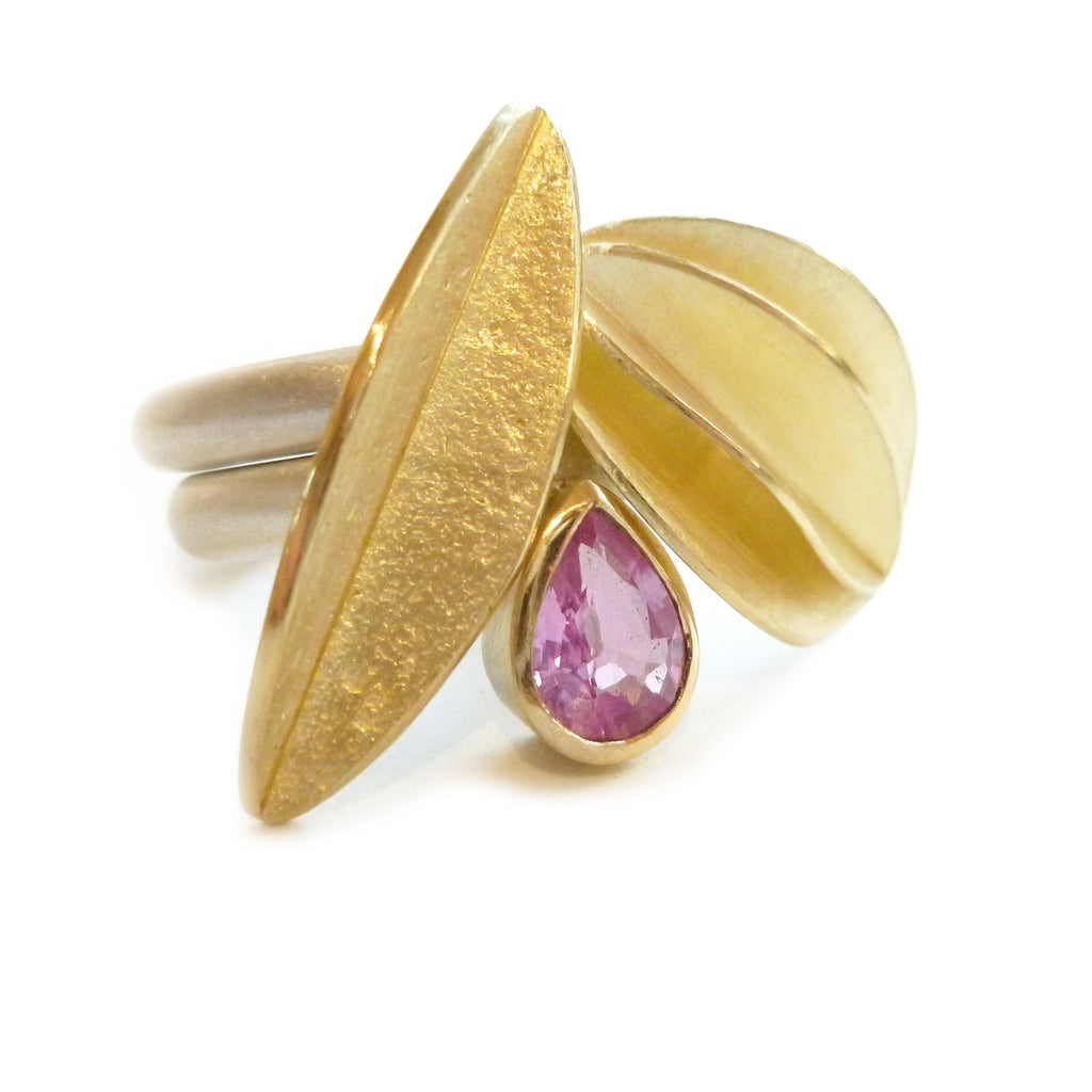 Unusual, unique, bespoke and modern statement gold and pear shape baby pink sapphire stacking ring set handmade by designer maker Sue Lane contemporary Jewellery, UK