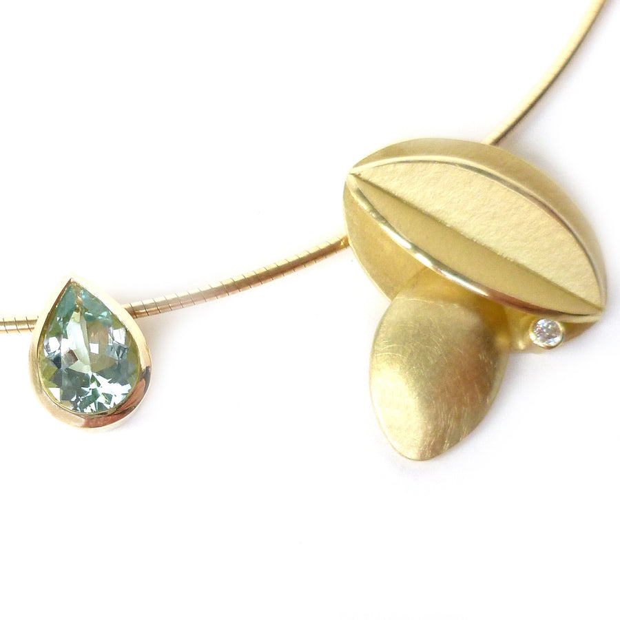 Contemporary bold and modern gold and aquamarine necklace handmade by designer maker Sue Lane Jewellery UK. Made to commission