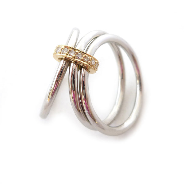 Modern engagement wedding stacking ring in platinum and gold with diamonds
