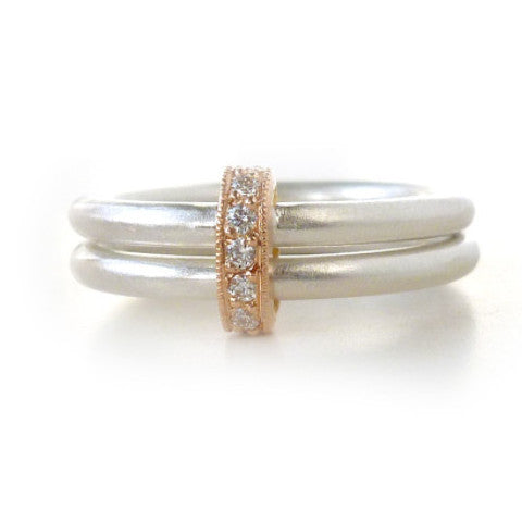 Contemporary and modern silver ring with rose gold and 7 pave set diamonds. Perfect for a wedding ring, or unique eternity ring or gift. Handmade by Sue Lane