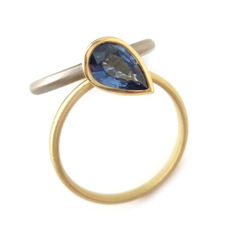 Unique, modern and contemporary two band ring, set with a pear shape blue sapphire. Dress ring or alternative engagement ring. Handmade in UK by Sue Lane.
