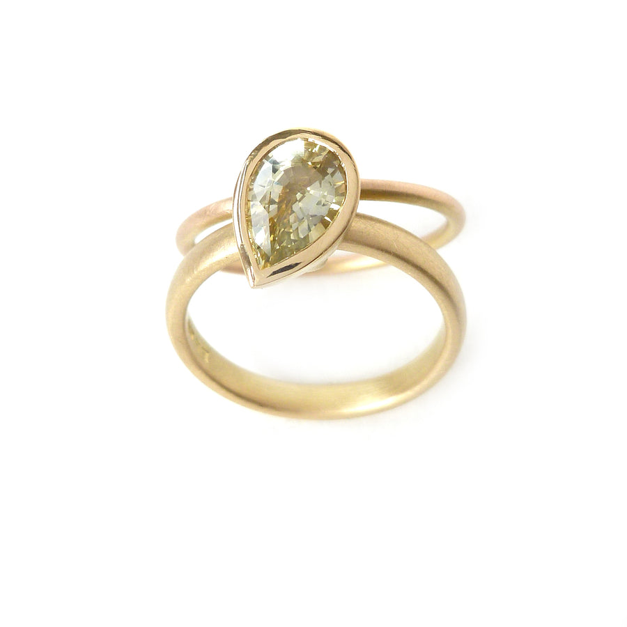 Unique, modern and contemporary ring, set with a beautiful green sapphire. Perfect for a alternative wedding and engagement ring. Handmade in UK by Sue Lane.