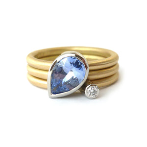 Unique, bespoke and modern statement platinum and gold and pear shape cornflower blue sapphire stacking ring set handmade by designer maker Sue Lane Jewellery