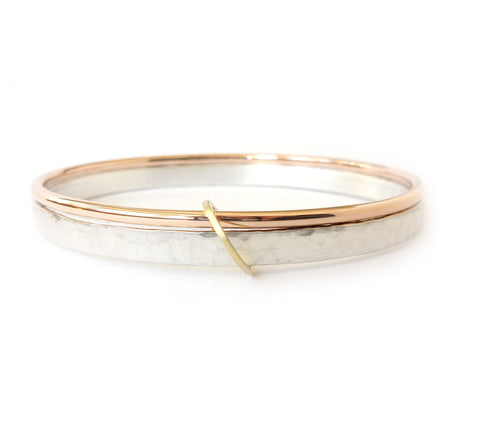 Unusual, unique, bespoke and modern three colour gold and silver bangle with brushed finish. Handmade by Sue Lane Contempoary Jewellery in Herefordshire, UK