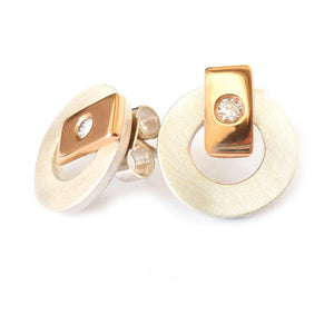 Contemporary and modern earrings in silver and 18k rose gold with a flush set diamond handmade by UK designer maker Sue Lane jewellery