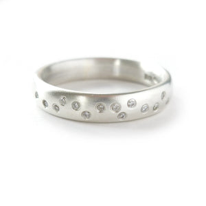 Usual, unique, bespoke and modern silver and 12 diamond dress ring, wedding ring, eternity ring, engagement brushed finish. Handmade by Sue Lane Jewellery UK