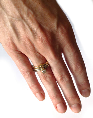 modern and unique chunky gold and diamond stacking ring set. Unique modern eternity ring or engagement ring