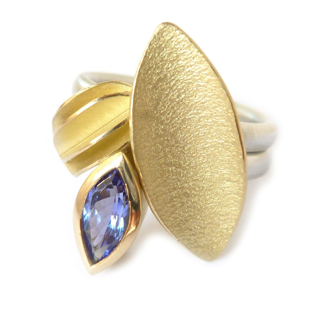 Unique, bespoke and modern statement tanzanite silver and gold stacking ringset handmade by designer Sue Lane contemporary Jewellery, UK