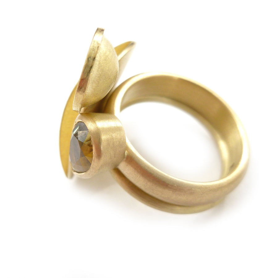 Unique, bespoke and modern statement gold and pear shape green/yellow sapphire stacking ring set handmade by designer maker Sue Lane contemporary Jewellery UK