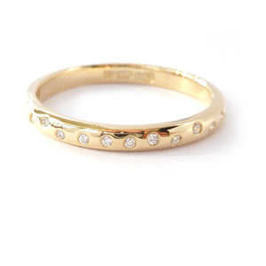 Contemporary and unique handmade gold 10 diamond modern eternity ring, bespoke wedding ring, or engagement ring by Sue Lane Contemporary Jewellery, UK.