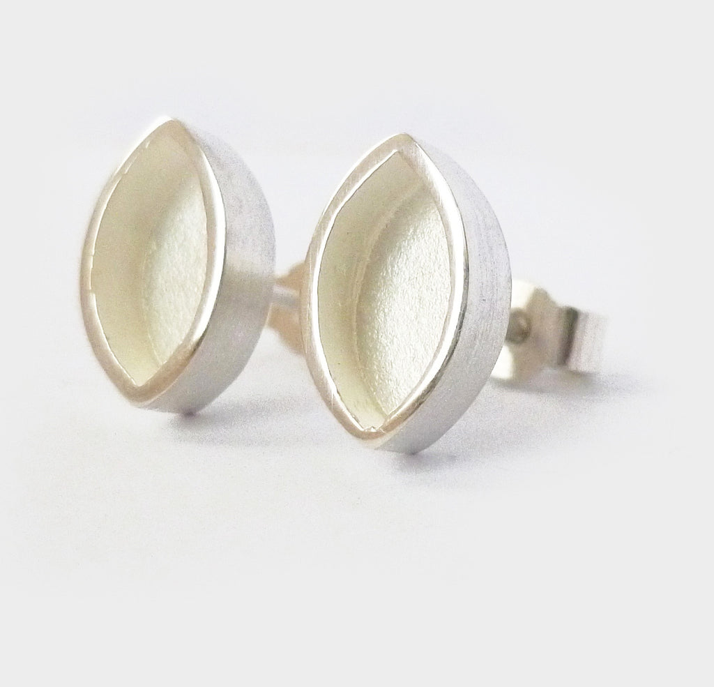 Contemporary, unusual and modern silver stud earrings handmade by UK designer maker Sue Lane jewellery.