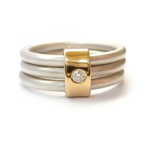 Silver and 18ct gold and diamond ring