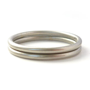 Modern delicate round section  halo wedding ring handmade by Sue Lane UK