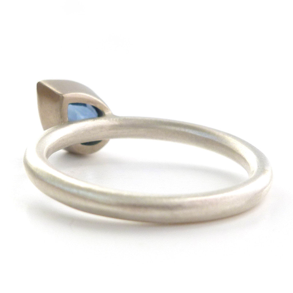 Contemporary, modern and bespoke silver and 18k gold cornflower blue sapphire pear shape stacking ring, handmade by Sue Lane Jewellery/ Alternative engagement