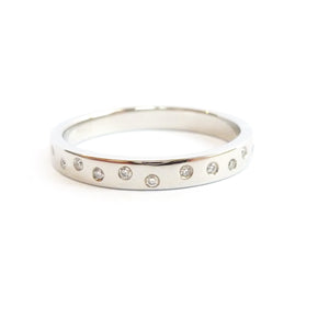 Contemporary platinum eternity ring. Bespoke jewellery by Sue Lane.