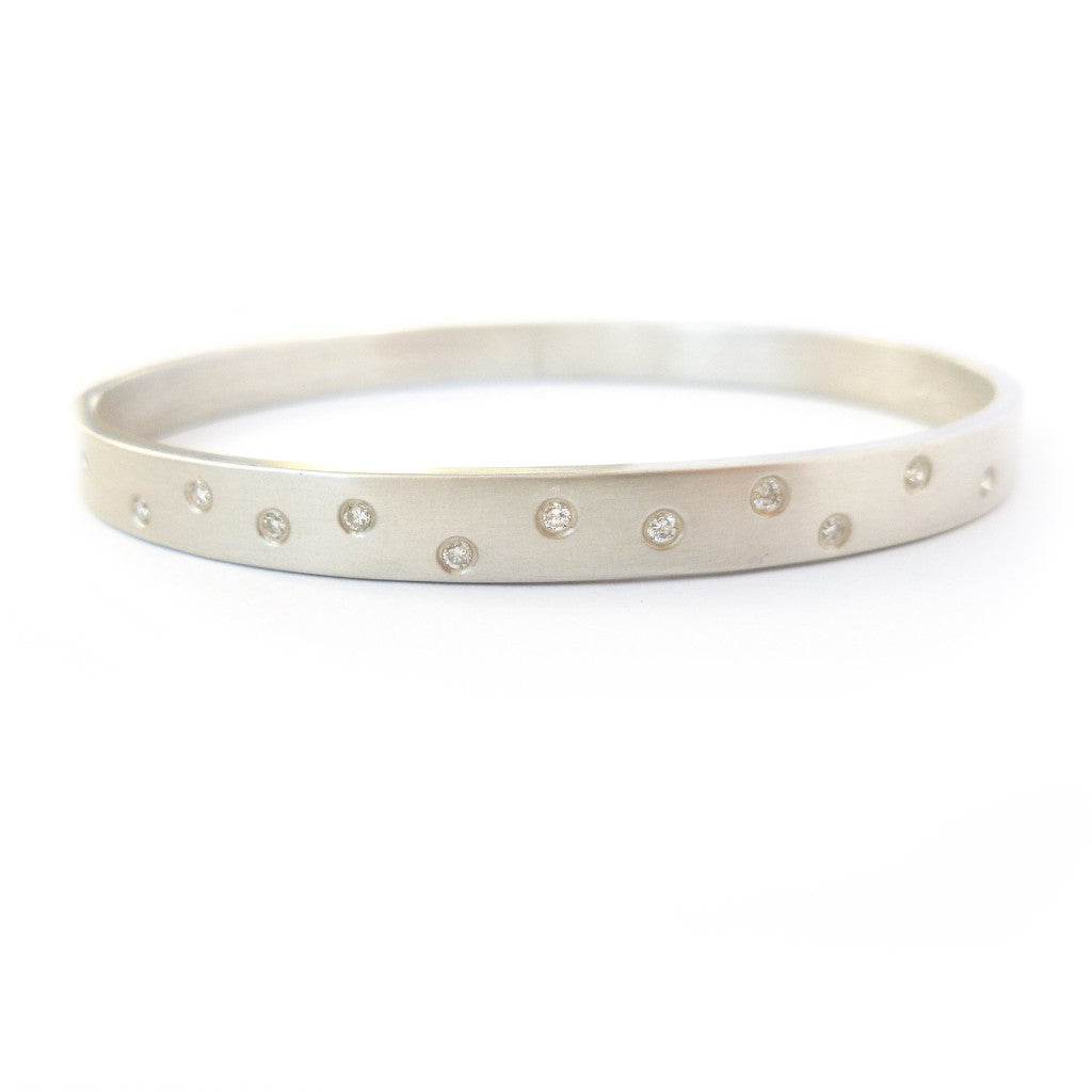 Contemporary, unique, bespoke and modern silver and diamond bangle with a matt brushed finish. Handmade by Sue Lane in Herefordshire, UK