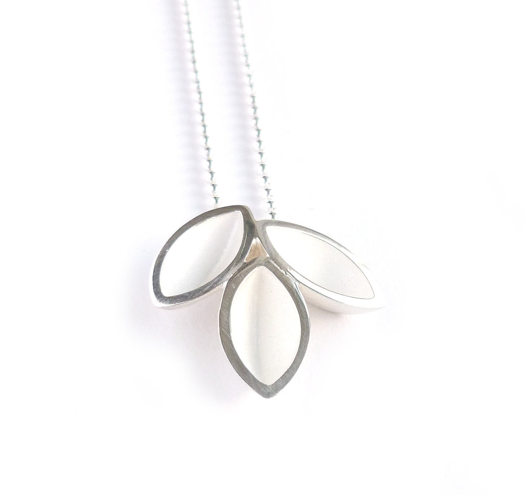 Unusual, unique, bespoke and modern silver leaf designer pendant necklace with brushed finish. Handmade by Sue Lane Contemporary Jewellery in Herefordshire, UK.