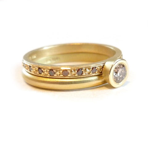 gold and pave set champagne diamond eternity wedding ring