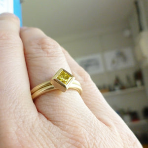 square yellow diamond staking ring