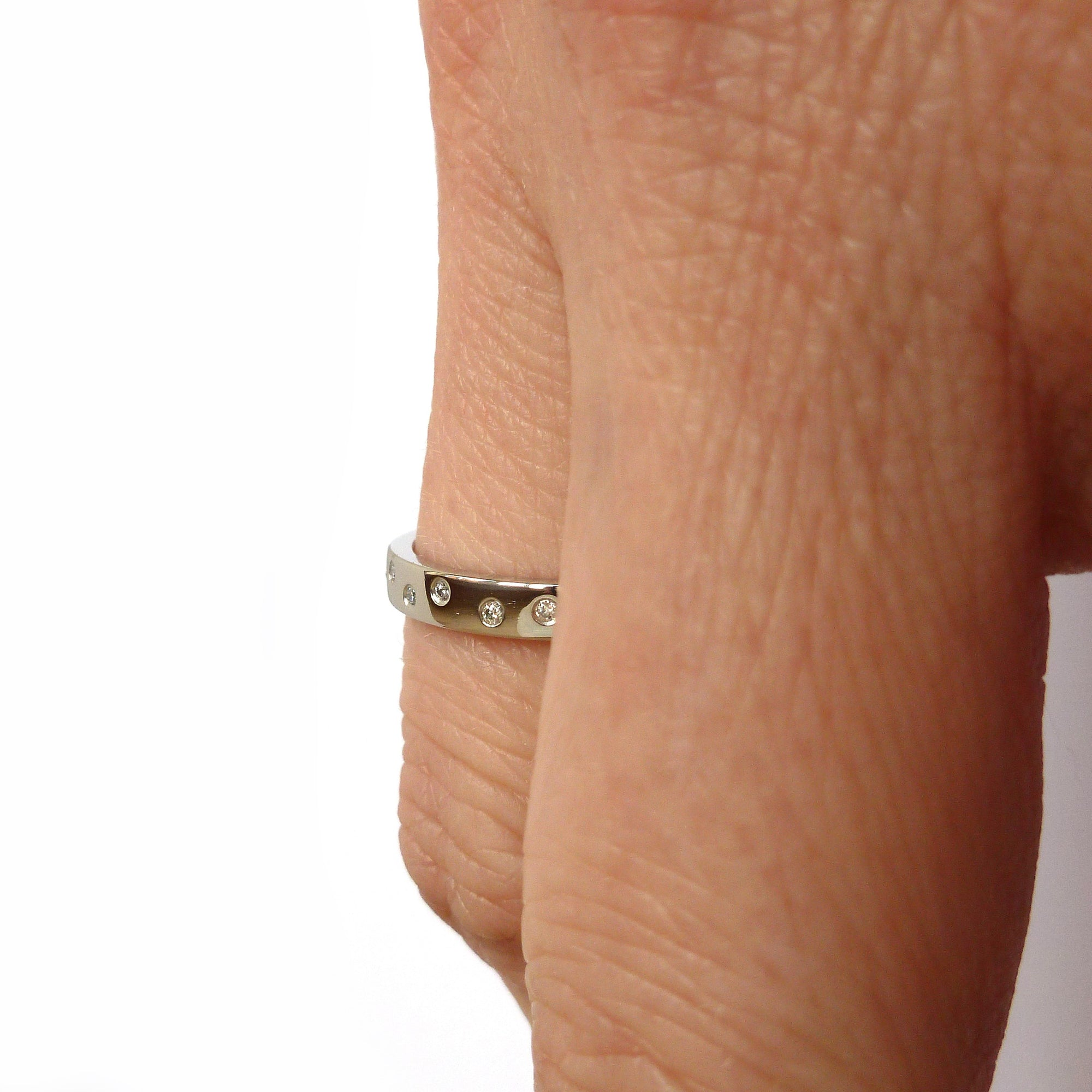 Contemporary platinum eternity ring, bespoke jewellery by Sue Lane