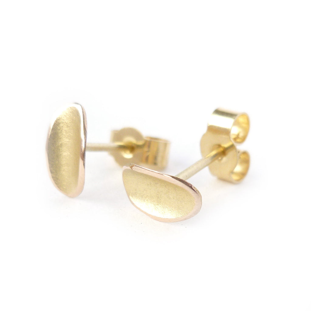 simple, small, discreet modern gold stud earrings with a unique touch. Handmade by Sue Lane Contemporary Jewellery