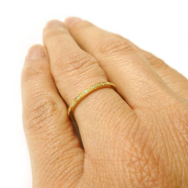 modern gold and pave diamond eternity ring made by designer maker sue lane UK