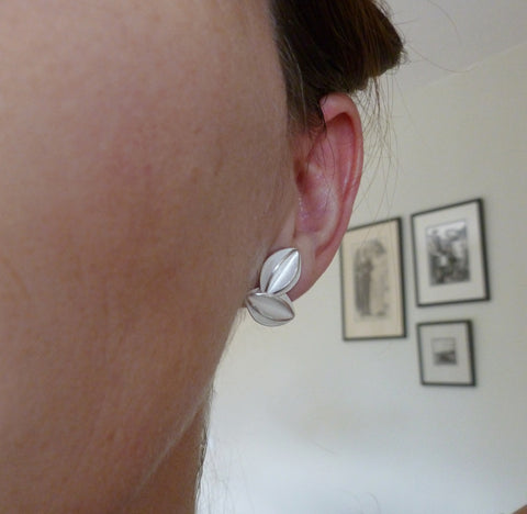 Unusual, unique, bespoke and modern silver stud leaf earrings. Handmade by Sue Lane Contemporary Jewellery in Herefordshire, UK.