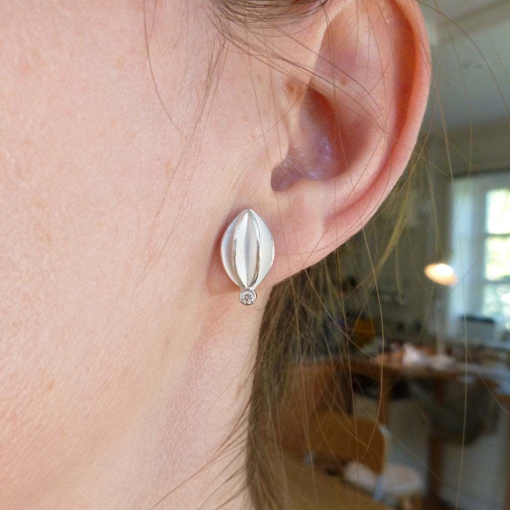 modern silver and diamond earrings