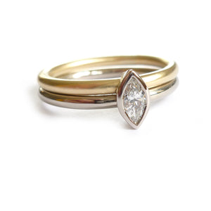 Two linking rings joined together making a special engagement ring. Multi band ring or interlocking ring, sometimes called double band ring too. Contemporary and bespoke.