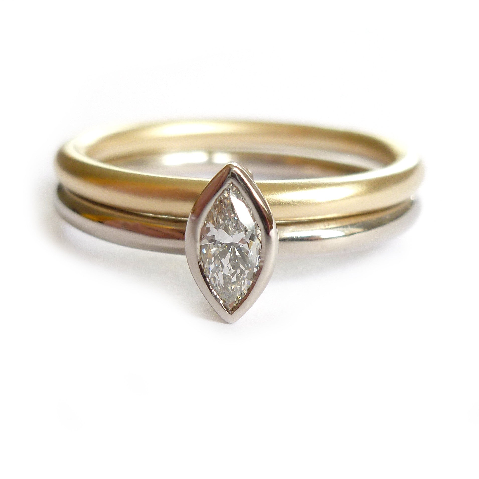Two linking rings joined together making a special engagement ring. Multi band ring or interlocking ring, sometimes called double band ring too. Contemporary.