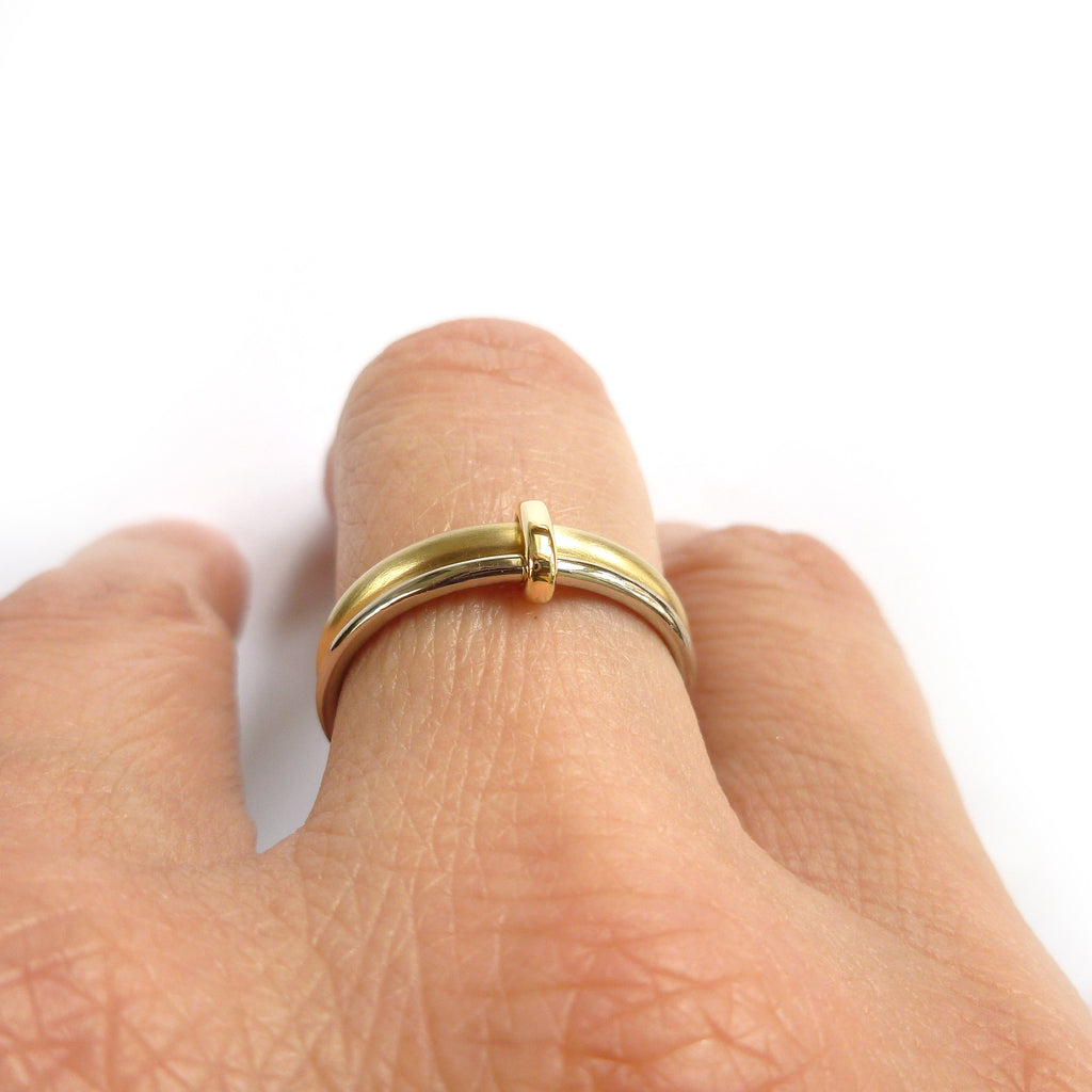 unique wedding ring linking together two bands of gold