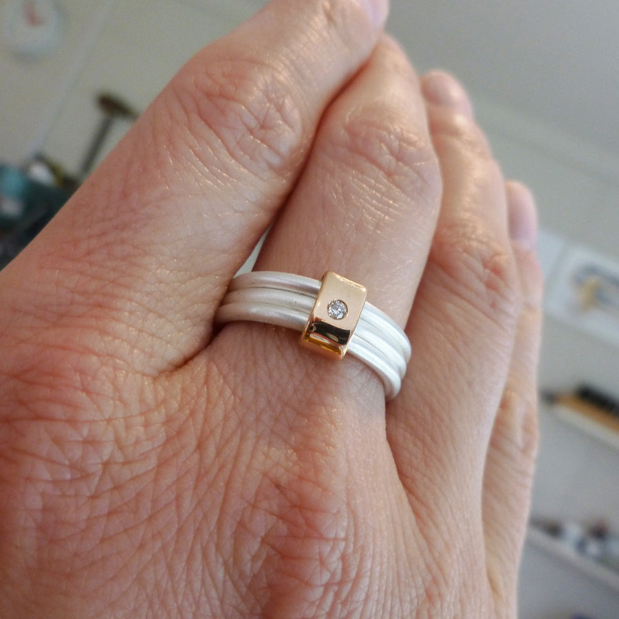Unusual, bespoke and modern diamond wedding ring in silver and gold. Handmade by Sue Lane Contemporary Jewellery in Herefordshire, UK. Unique wedding ring.
