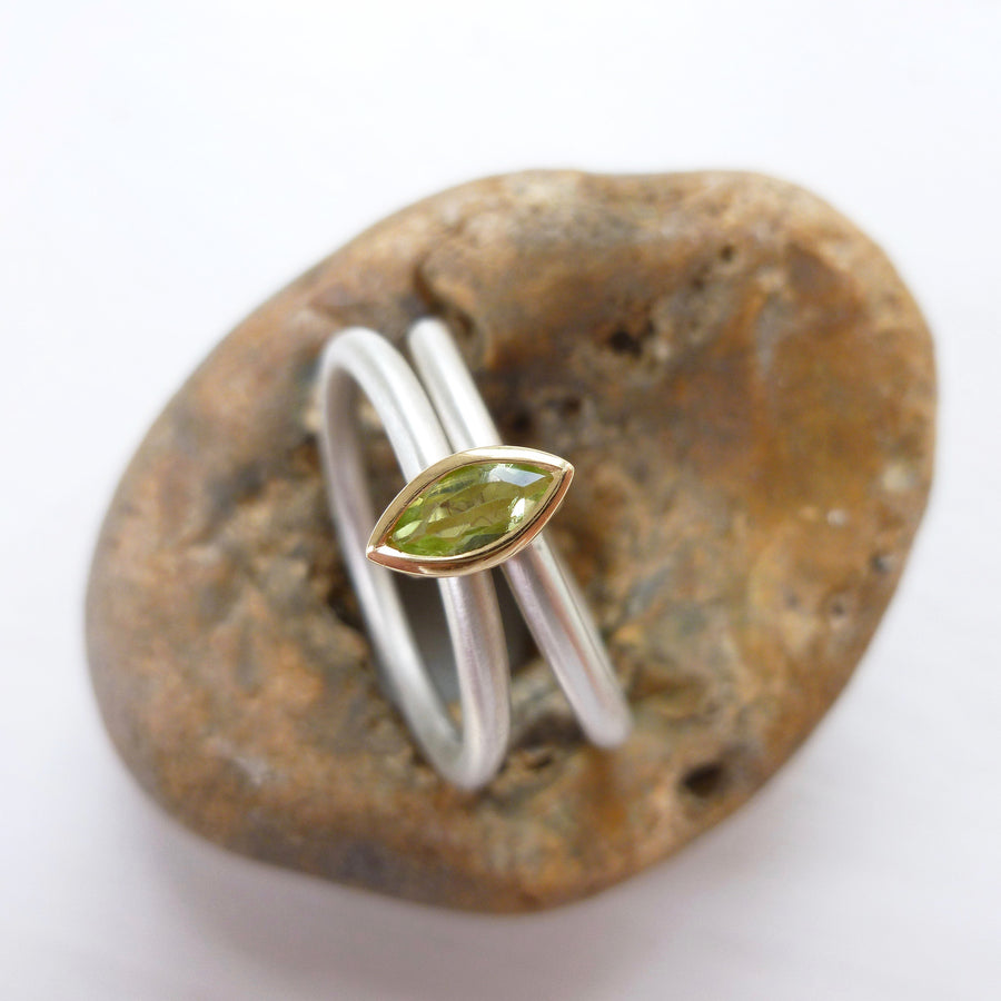Unusual, unique, bespoke and modern two band stacking ring in silver and yellow gold with green marquise peridot Handmade by Sue Lane Contemporary Jewellery UK