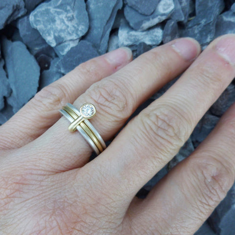 modern silver and gold 3 band stacking ring. Contemporary eternity ring or engagement ring. Handmade by UK designer and maker.