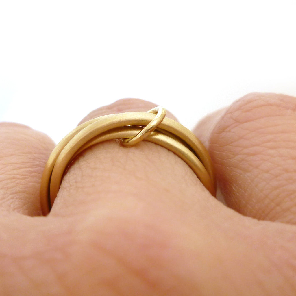 modern russian style wedding ring handmade in UK in yellow gold.