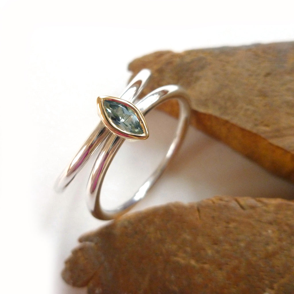 modern unusual silver and gold ring with aquamarine by contemporary jewellery designer Sue Lane