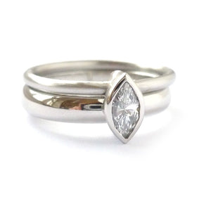 modern bespoke platinum and diamond two band ring handmade in UK. Multi band ring or interlocking ring, sometimes called double band ring too.