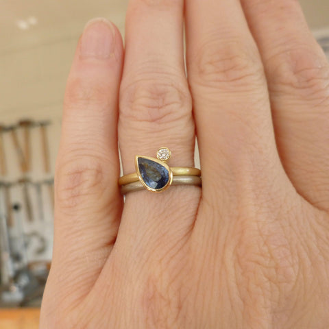 two band cornflower blue sapphire and gold ring