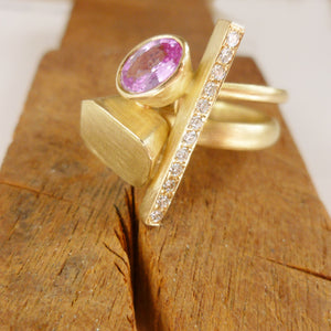 Pink sapphire and diamond and yellow gold ring