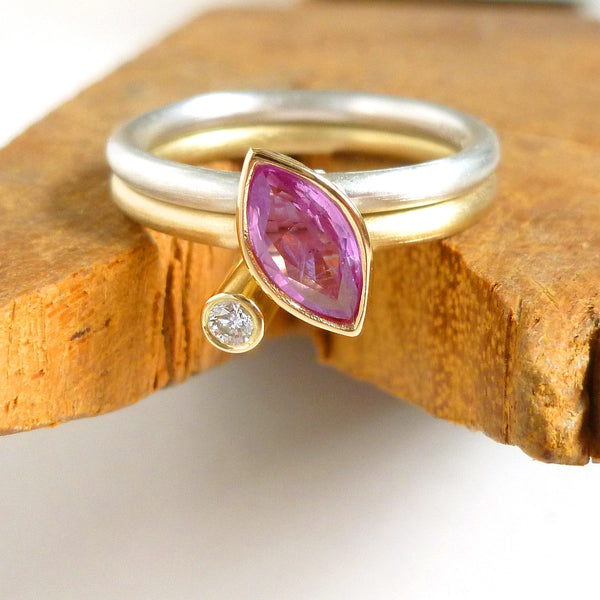 Modern gold and silver two band ring with marquise pink sapphire