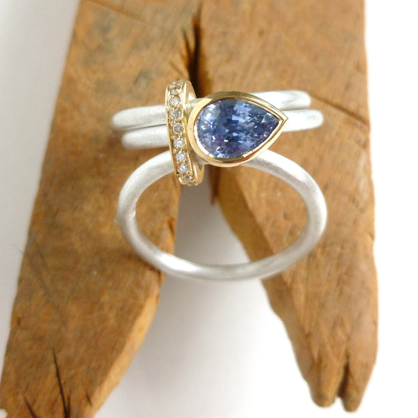 pear shape cornflower blue sapphire and silver modern eternity ring