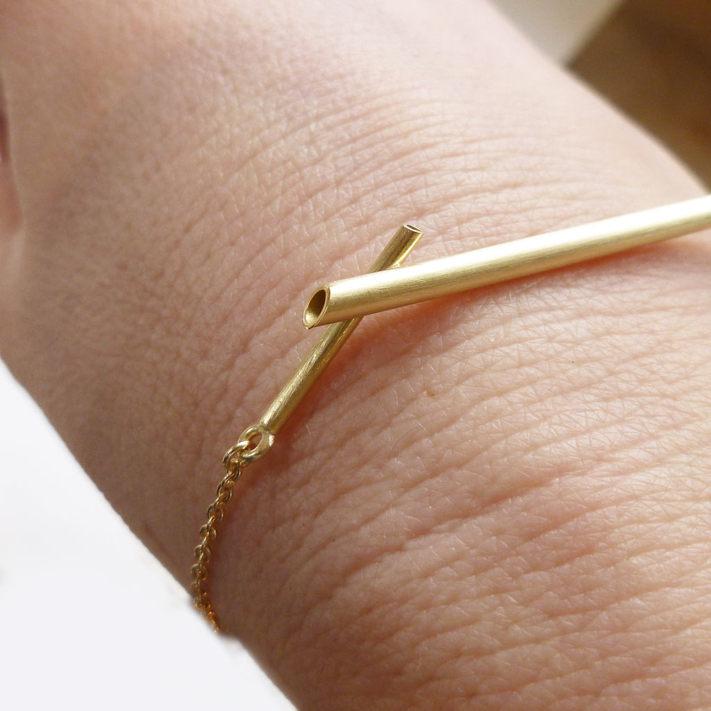 contemporary simple gold bracelet with chain for adjustment