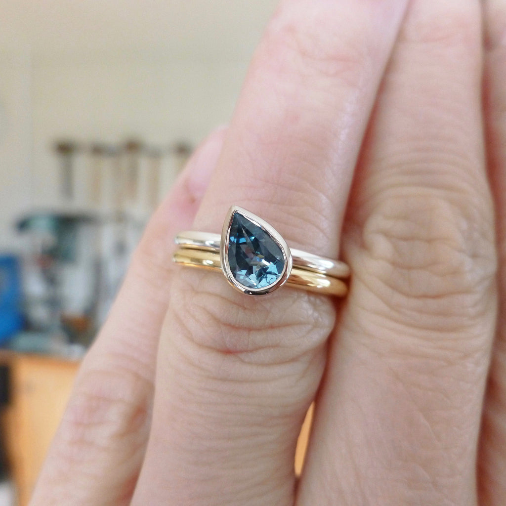 double ring with aquamarine in gold and silver