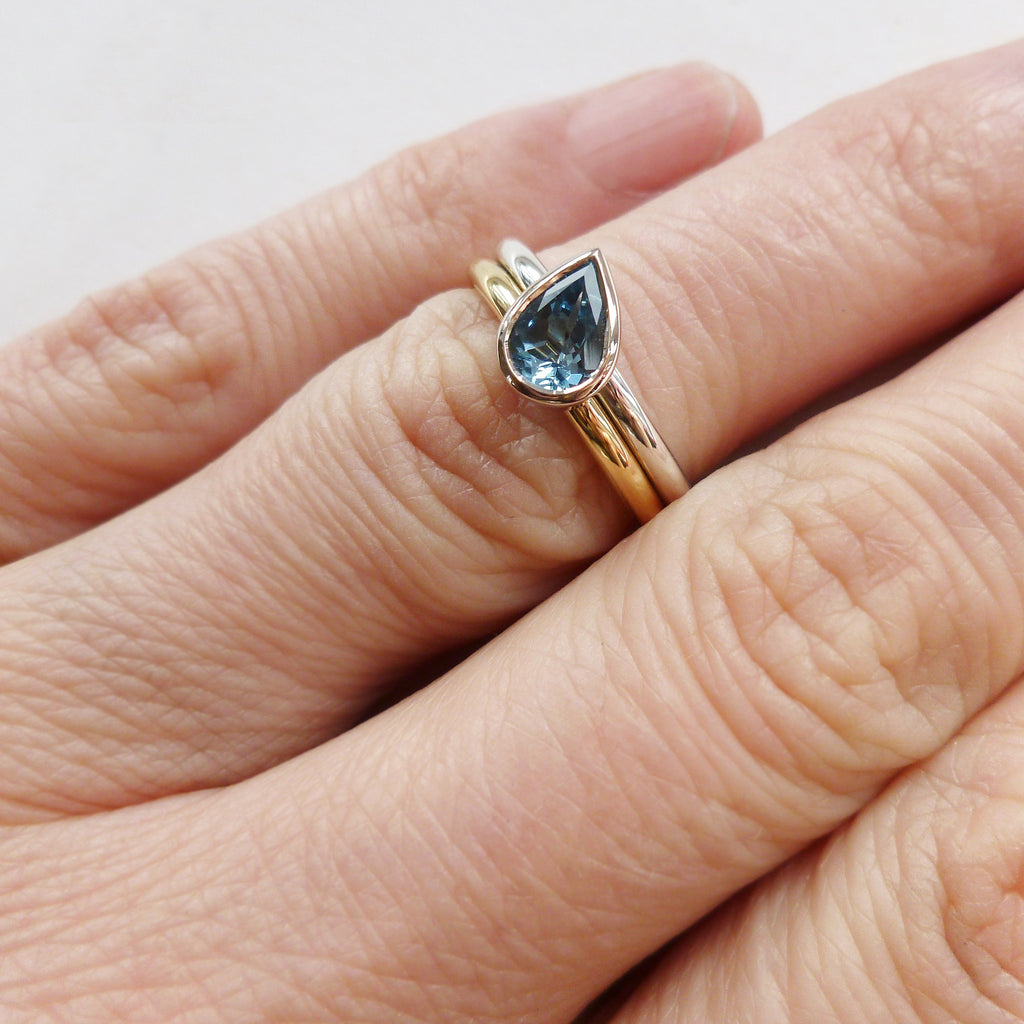 modern stacking double band ring with pear shape aquamarine