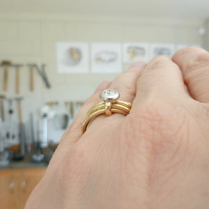 bespoke gold and diamond wedding and engagement ring in one. Multi band ring or interlocking ring.