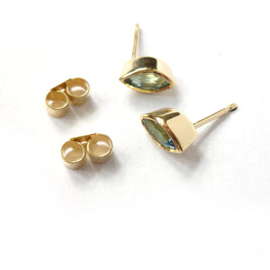 modern yellow gold and aquamarine stud earrings, perfect for a March birthday.