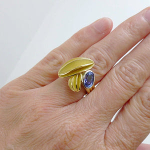 contemporary gold platinum and tanzanite ring with gold leaf shape detail handmade by Sue Lane UK