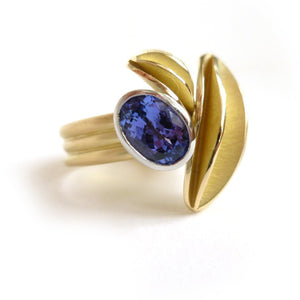 contemporary gold platinum and tanzanite ring with gold leaf shape detail by designer and maker Sue Lane