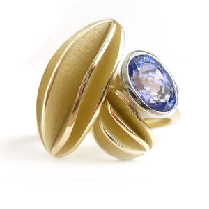 contemporary gold platinum and tanzanite ring with gold leaf shape detail